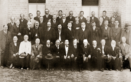 Brisbane Water & Wyong District Pioneers' Dinner, 1915 Front Row: (seated L to R): Silas Taylor, Joe Lilley, John Smith, W. Cottrell Snr, John Goldsmith, George Taylor, James Buscombe, John Robley, Ed Hawkins, J. Martin, Edward Beattie, William Coulter. 2nd Row (L to R): W. Baldwin, John Ree, Charles Peck, Allan Waters Snr, allan Waters Jr, James Kibble, George Smith, Manasseh Ward, Harry Morris, James Boyd, Michael Smith, F. G. McPherson. 3rd Row (L to R): Patrick Humphreys, William 'Jilliby' Smith, Fred Salmon, –?- Harrison, J. Morris, Matthew Woodbury, Albert Walmsley, S. Wright, George Jaques, H. Moir. Back Row (from centre of first window): Fred Klumpp, Joseph Bailey, Thomas Murray, Mick Perry, Edward 'Ned' Kennedy, H. Mead, W. Cottrell Jr, James Harvey.